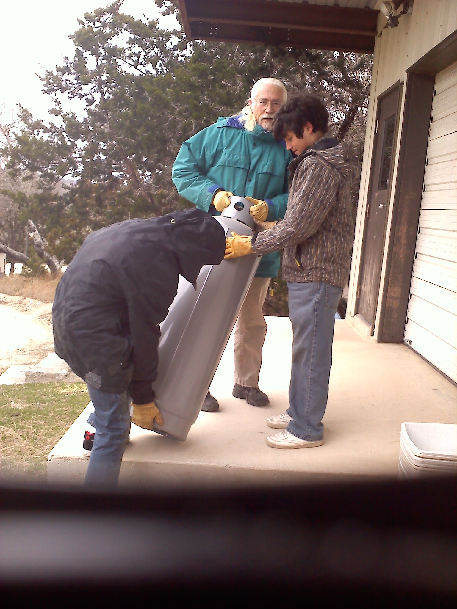 DAVE, TOM, AND GUY WORKING ON PLAN TWO THE GIANT PROPANE HEATERS